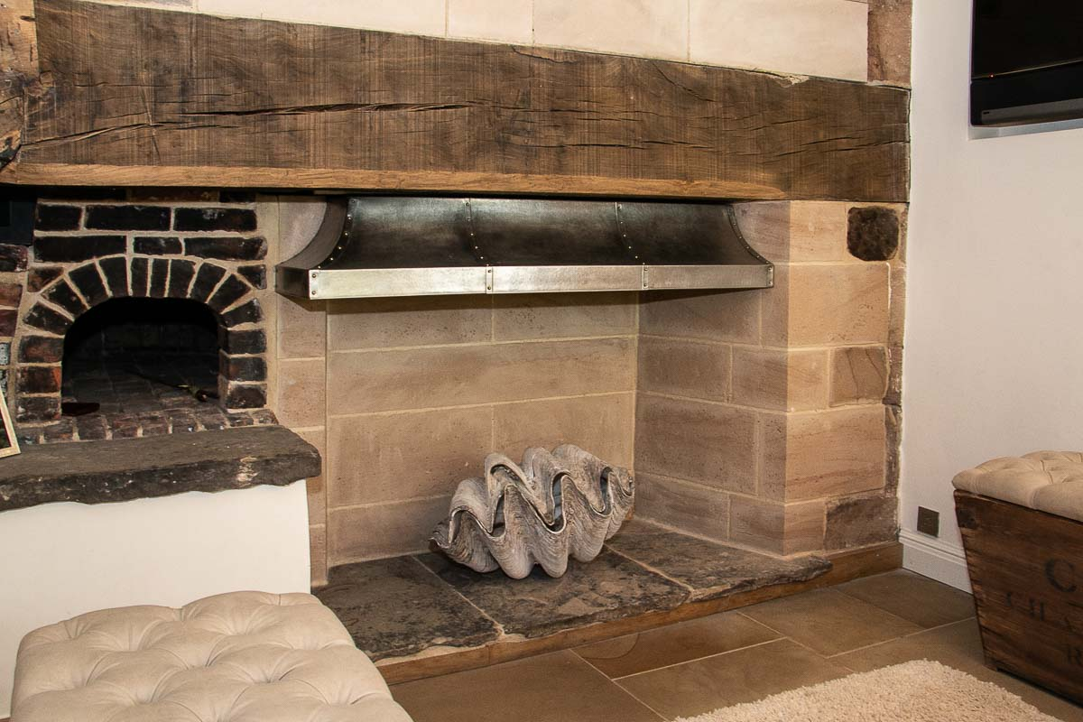 Double walled stainless steel fire canopy for a medieval manor house