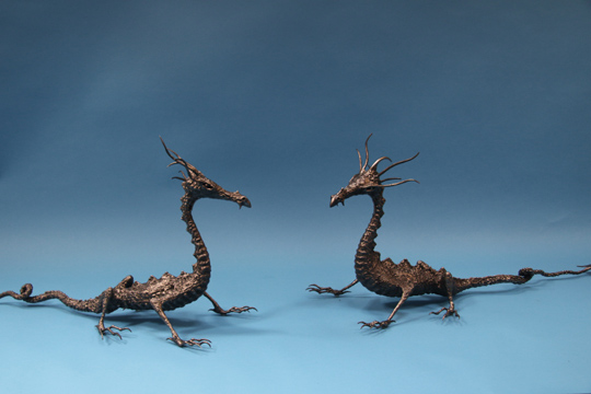 Two metal dragons