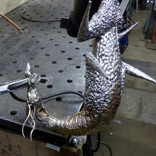 Stainless steel dragon sculpture being made