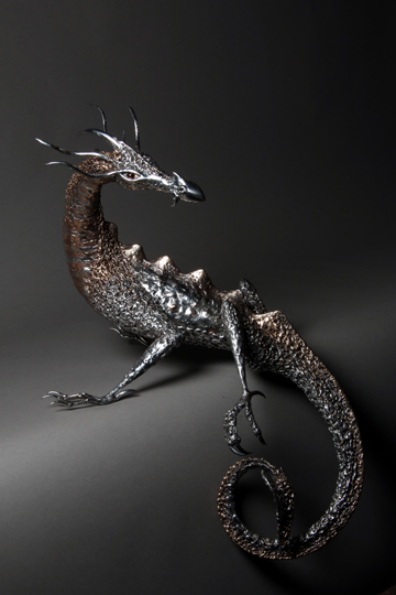 polished stainless steel and bronze dragon sculpture