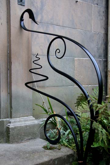 creative artistic metal handrails outside period property