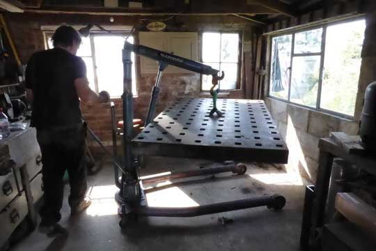 Lifting the platen with an engine crane