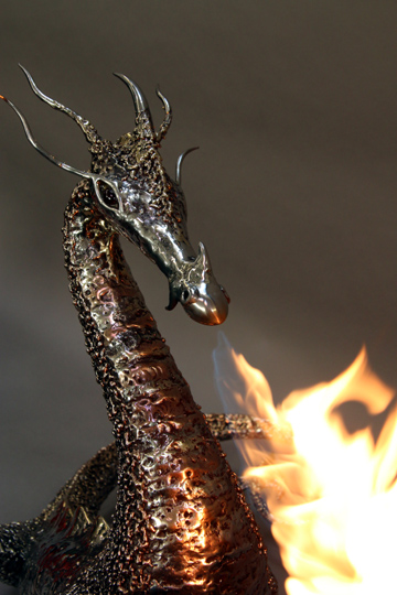 fire breathing bronze and stainless steel dragon sculpture