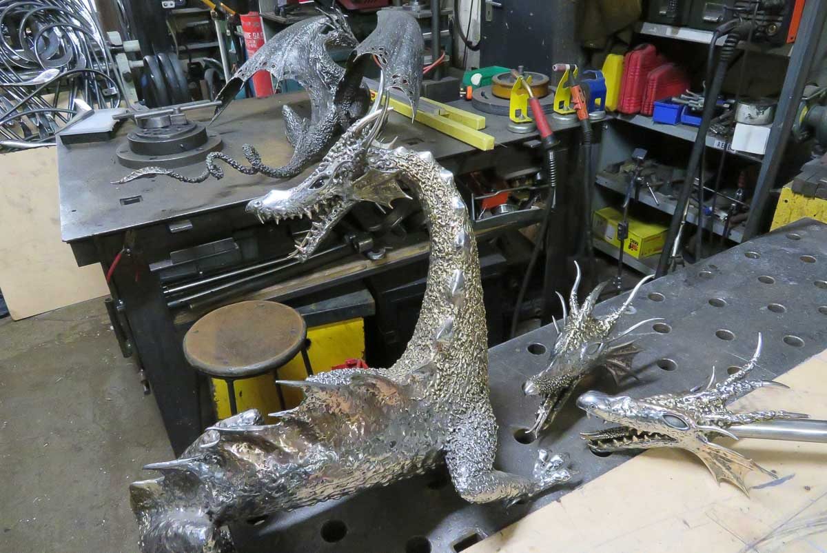 fire breathing dragon sculptures being made