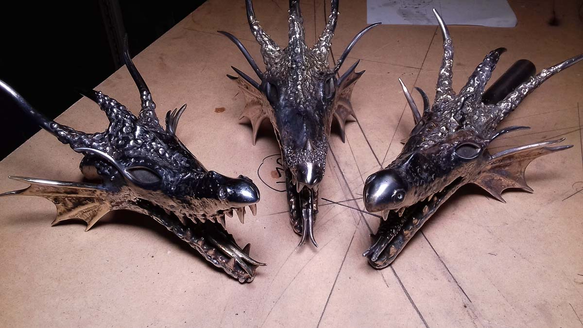 Three stainless steel dragon heads nearly finished