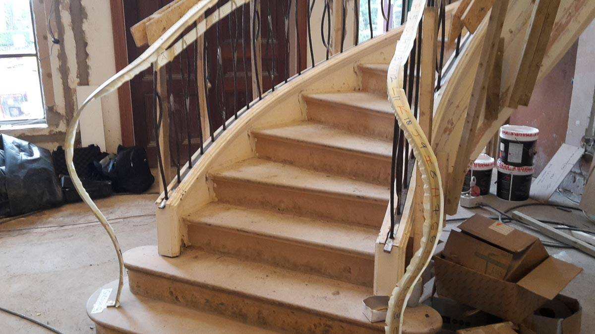 Feature newel posts formed from handrails elliptical stairs