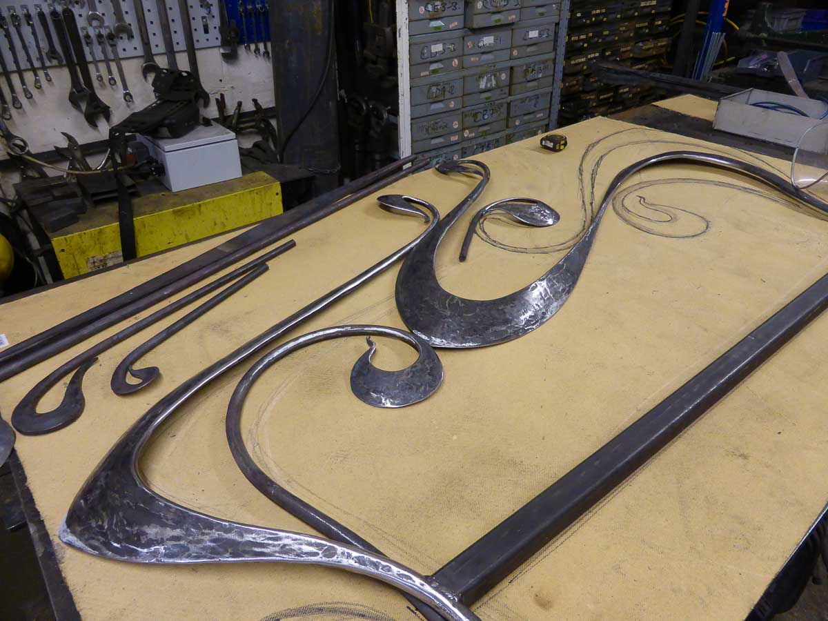 Hand forged art nouveau bed being made