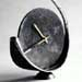A forged steel clock