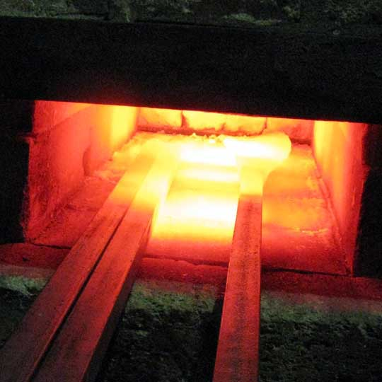 Steel bars being heated in blacksmith's forge