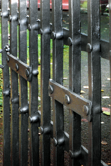 innovative wrought iron arch gate riveted joinery
