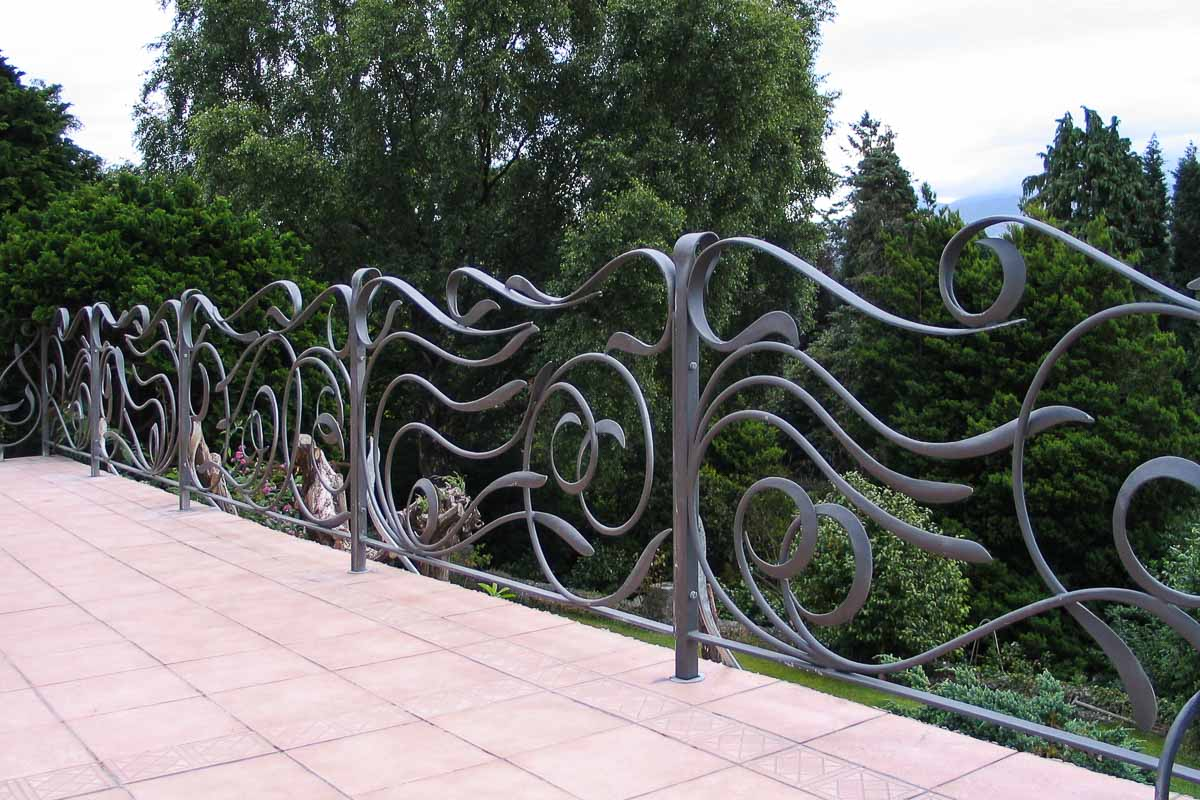 Contemporary flowing wrought iron railings