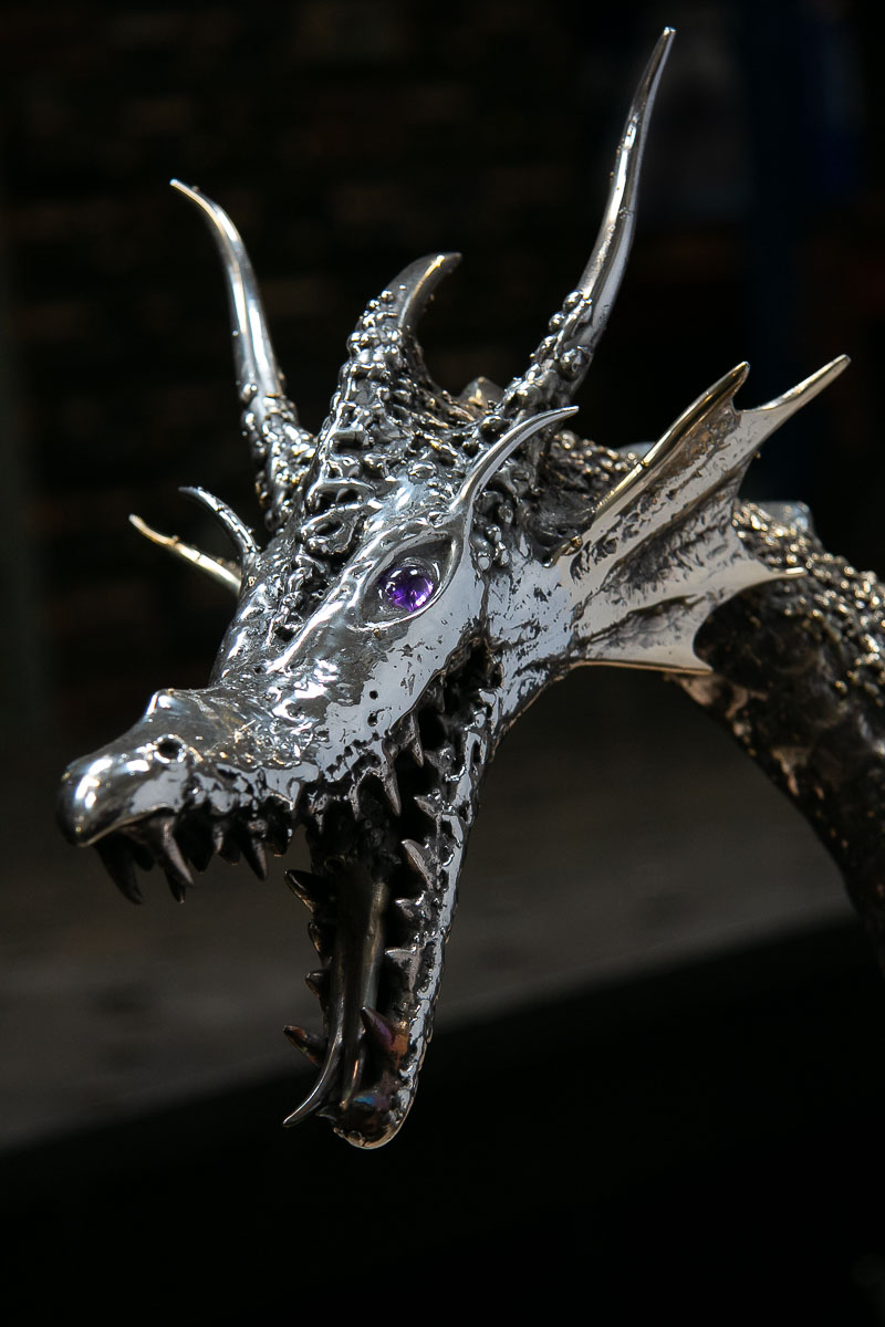 Stainless steel dragon face with amethyst eyes