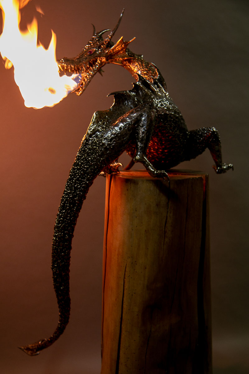 Stainless steel fire breathing dragon sculpture