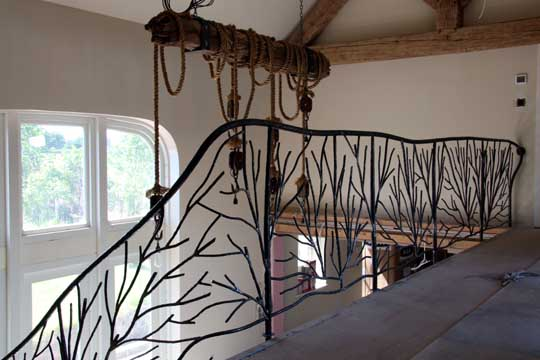 The stair railings were based around abstract tree sculptures