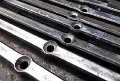 Hot punched holes in steel bars