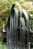 Contemporary wrought iron arch gate